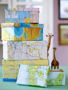 Shoeboxes wrapped in maps make great storage boxes!