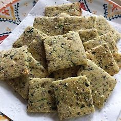 Killer Crackers - keto 1 tablespoon coconut oil  4 teaspoons chopped onion  2 cloves garlic, minced  3 1/2 tablespoons chopped fresh mushrooms  1 tablespoon frozen chopped spinach, thawed and drained  1/3 cup almond flour  1/3 cup coconut flour  2 tablespoons flax seed meal  1/2 teaspoon salt  1 pinch ground black pepper  2 eggs  2 tablespoons water  1 tablespoon olive oil