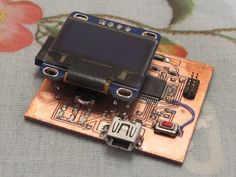 One Maker has created a minimalist Arduino Zero-like board with an OLED display…