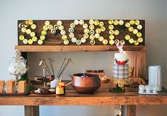 Smores station with DIY Party Marquee Backdrop (made from a string of lights & mini solo cups) (Holiday Party Top) Chocolate Party, Hot Chocolate Bars, Creative Party Ideas, Christmas Party Favors, Hot Cocoa Bar, Party Packs, Animal Party, Diy Party, Favorite Holiday