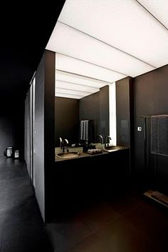 Bathroom Armani style. I like the idea of dimmed lighting across the entire ceiling.