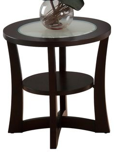 Wooden coffee table with glass insert - a contemporary unit to display a rare collection.