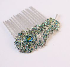 Hey, I found this really awesome Etsy listing at https://www.etsy.com/listing/210624063/teal-blue-peacock-feather-hair-comb