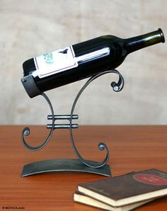 Iron wine bottle holder perfect for a 6th anniversary gift $57.99