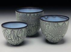 Three Bowls, Naked Raku technique with peeled away slip and overglaze, colored terra sigillata. 4-7H.