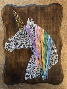 Handmade unicorn string art. Great for hanging or freestanding. I can add sawtooth hanging hardware upon request. Check out my store for other string art pieces! I can make custom designed string art pieces upon request. Just let me know what you are interested in! Contact for pricing