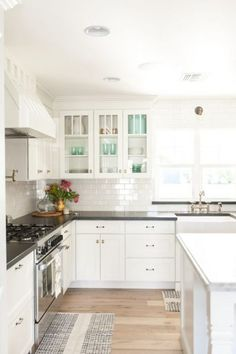 Tour this stunning home with classic white kitchen, subway tile and glass cabinets kellyelko.com