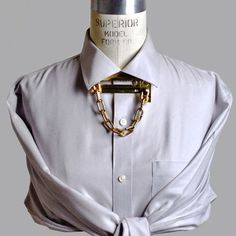 A new interpretation—and we'll go as far as to say, a needed upgrade—to the traditional bowtie, Bond Hardware's Chain Lock Necklace is similarly meant to be worn under the collar of a blouse or a dress shirt. A little less buttoned-up and a bit more BDSM, this accessory is sexy and sophisticated; an avant-garde garment enhancer with a playful dose of kinky kitsch, to be worn by the fashionably-fearless and the chicest curios.