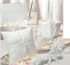 Exquisite embroidery highlighted with iridescent sequins is featured throughout this delightful Sweet Art wedding set.