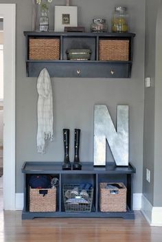 Entryway for a small space. Love the storage and bench for putting on shoes.