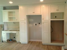 Work in progress! Cottage White kitchen cabinets with a light taupe glaze on these cabinets with inset doors. All custom designed by Dixon Custom Cabinetry in NC!