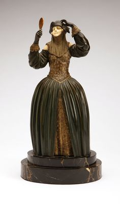 Demetre H. Chiparus, a cold-painted and patinated bronze and ivory figure, ' Circa 1930, signed to bronze body ''Chiparus'' (Demetre Chiparus 1886-1947 Romanian / French), edited by Etling, depicting a standing lady in a tri-cornered hat and a full-skirted dress holding a mirror and a mask, on a stepped oval black marble plinth/