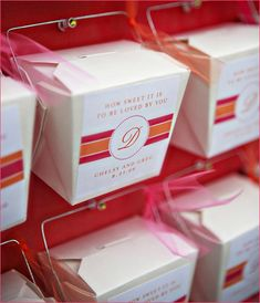 Totally doing this for my next party.   Party favours in takeout boxes posted on a giant board.