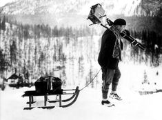 pictures A sports photographer of the Winter Olympics in St. Moritz carrying his equipment on a sled. 2022 Winter Olympics, Yellow Lab Puppies, Snow Sled, Good Old Times, Vintage Winter, Ski Fashion, Winter Pictures, Beijing, Black And White