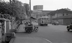 downtown city hall 1966 Capitol Building is in the background; the drinks cart is in front of the old RI, currently Raffles City; Chijmes is to the left