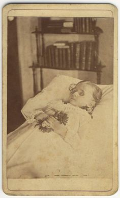 Memento mori. This child has been sick s long time. Eyes are hollow.