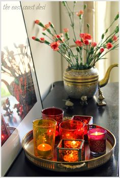 Group pretty colored tea light holders together for a punch of colored glow