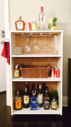 DIY bar cart from cheap target bookshelf ! Add casters, grab bar, and stemware storage. All you need is a screwdriver to make this for cheap!
