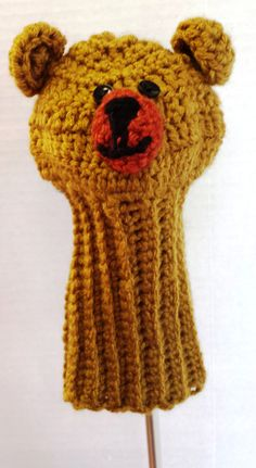 This adorable brown bear, golf head cover provides great protection for your clubs. The club head cover features a long neck sock to provide extra club shaft protection. It is a wonderful gift idea for the golfer in your life. These Golf Club covers will fit most sized clubs. https://www.etsy.com/your/shops/CrochetedHeadwear/tools/listings/section:18557873,view:table,stats:true/248673063