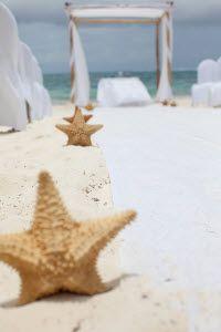 a soft, warm beach wedding decor