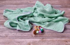 Toddler muslin blanket with mini Pom Pom trim / mint & lavender Muslin Blankets, Muslin Swaddle Blanket, Gift Of Time, Toddler Blanket, Pom Pom Trim, Trim Color, Color Shades, Organic Cotton, Lavender