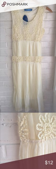 """Flower Lace Dress! Ivory flower laced dress with pleated bottom half. Dress material 95% polyester, 5% Spandex. Dimensions- Bust: 16"""", Waist: 12"""", Length: 38"""". Size medium. DRESS HAS NEVER BEEN WORN AND TAGS INCLUDED! Aqua Blue  Dresses Mini"""