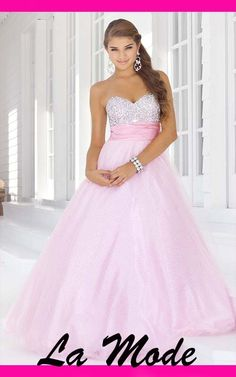 High Quality Floor Length Beaded Prom Dress via La Mode. Click on the image to see more!