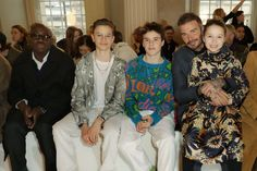 David Beckham and children Harper, Romeo, and Cruz stole the show in London. The Beckham Family, David Beckham, Celebrity Crush, Celebrity News, David And Victoria Beckham, Album Of The Year, Family Affair, Orange And Purple