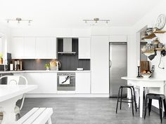 This is something like the way I imagined the kitchen space to work. Good size L-shaped area, with simple white storage and a feature splash back. It would of course not be possible with the chimney and possibly work better if there was a moveable island to add more bench top space.