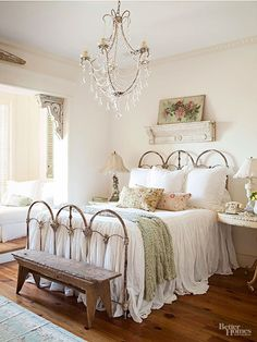 With so many layers of white in this cottage bedroom, texture leaps to the forefront to distinguish each element. Notice that each shade of white differs a little from the others, and intriguing textures -- chipped paint on the corbels and shelf, pocks on the wooden bench, open stitches on the throw, and ruffles and gathers on the linens -- catch the light differently to tantalize the eye.
