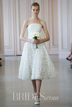 A short @oscarprgirl wedding dress we love for a spring garden wedding | Brides.com