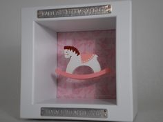 One of our classic designs using the wooden rocking horse, and pink patterned background from www.giftedwithwords.com