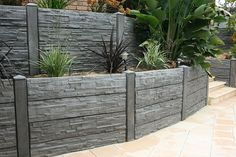 A retaining wall is a perfect DIY project for a variety of skill levels. We have rounded several retaining wall ideas to decorate and build your landscape. Concrete Patios, Concrete Sleeper Retaining Walls, Concrete Sleepers, Backyard Retaining Walls, Garden Retaining Wall, Backyard Landscaping, Concrete Walls, Landscaping Ideas, Cheap Retaining Wall
