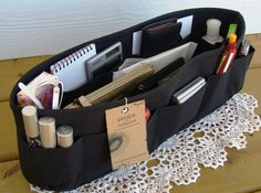 I bought a 2pk of these online and they are a must for the girl that carries everything but the kitchen sink in her purse!! If you constatnly dig through your purse to find things then these will be a lifesaver!! Purse insert ORGANIZER SHAPER / Bag Organizer by DivideAndConquer