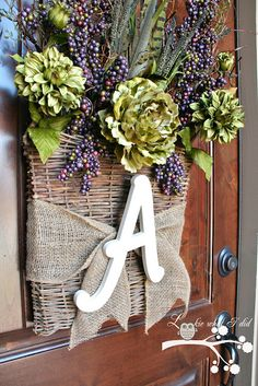 Front door basket w/monogram - clever and pretty and minimal flowers needed for a big impact pop of color