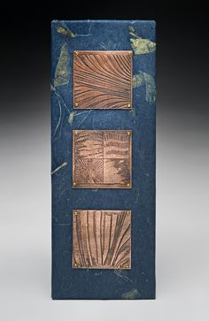 3 etched copper squares