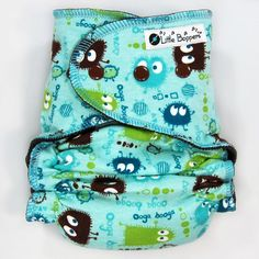 This listing is for a Made-to-Order (You Pick Size and Style) All-in-Two Cloth Diaper in the Aqua Ooga Booga print. The pictures are representative of the print (made into a Medium Long Wind Pro AI2), but your specific diaper may look slightly different.  Little Boppers™ handmade All-in-Two cloth diapers are plush, stylish and stashworthy. Super easy...just put it on your baby and go! No separate cover needed. Add one to your babys cloth diaper stash today!  Features: - Quick-dry design…