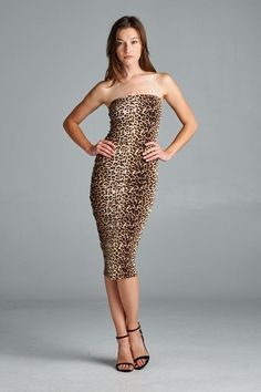 Sexy leopard-print tube dress (D4972). Fits very well, is soft and is comfortable. Made in USA. Check out more of our alluring tube dresses from our current collection. Young contemporary everyday wear. Stylish and comfortable.  www.cherishusa.com www.fashiongo.net/Cherish