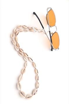 Bring your Summer Style to the next level! Boho Sunglasses Chain with natural Cowrie Shells and this is your go-to Beach Accessory!   SPECSET #boho #sunglasses #bohostyle #eyewear #womenfashion #beachstyle #summerstyle #bohemian #fashionstyle #glasses #eyeglasses #eyeglassholder #handmadejewelry #specset #eyewear #accessories #giftforher #beachsummer Trending Sunglasses, Sunglasses Women, Eyeglass Holder, Beach Accessories, Sea Shells, Eyeglasses, Boho Fashion, Eyewear, Handmade Jewelry