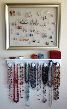 I made an earring holder like this with some foam taped to a back of an open frame. Then hung a curtain rod on the back of a door to hand necklaces and bracelets. Like this shelf too.