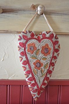 Primitive Folk Art Heart Cupboard Hanger Needle Punch PDF Pattern by AnnieBeez on Etsy https://www.etsy.com/listing/176758160/primitive-folk-art-heart-cupboard-hanger