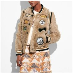 Coach Shearling Varsity Jacket With Patches ($1,000) ❤ liked on Polyvore featuring outerwear, jackets, bomber, neutral, teddy bomber jacket, button jacket, american jacket, beige jacket and varsity jacket