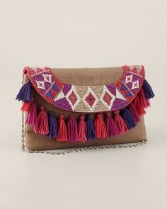 Ava bag by Chicos. Quirky boho number with cute tassels.