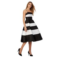 Chic and feminine, this prom dress from Debut will make an ideal addition to an occasionwear collection. In a fit and flare silhouette, this stylish piece features an elegant monochrome palette enhanced by stripes and netting on the skirt for a full effect. Finished with a bow waist, it is perfect for teaming with heels.