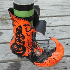 Witches shoe.  I think the base, or sock, is a Pringles can