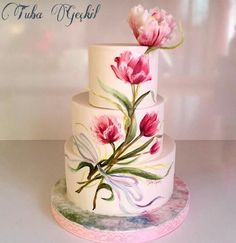 Cakes stacked to edge, trompe l'oiel (spelling?) painting, with leaves that protrude here and there and matching flower on top.  This person has awesome talent!
