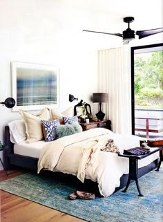Madeline Weinrib Blue Luce Ikat Pillows in the home of designer Athena Calderone, via Living Etc