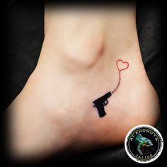 Tattoo vintage gun on one of the best place on your body created by Acanomuta Tattoo Studio.