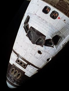 Chris Hadfield: Moustache visible through the Shuttle's window.  Interesting how rough-textured the thermal blankets and tiles were. Amazing spaceship to fly - this photo was taken from Mir.