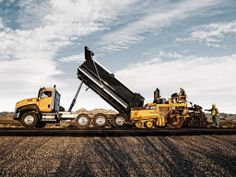 CATERPILLAR CT660 dump truck and a CAT road paver. #heavyhauling